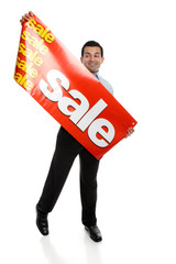 Big Sale - man putting up a SALE banner sign