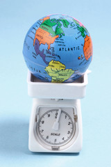 Globe on Weighing Scale