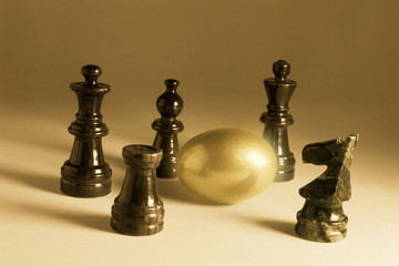 Chess  Pieces and Golden Egg