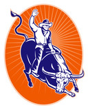 rodeo cowboy riding jumping longhorn bull