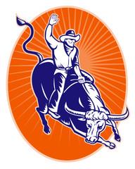 rodeo cowboy riding jumping longhorn bull