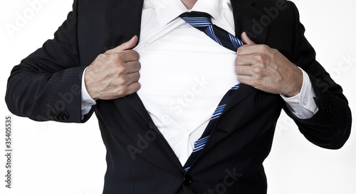 Superhero businessman opening shirt
