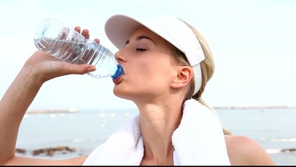 Portrait of jogger drinking water