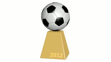 Fußball drehend auf goldenem Sockel 2012