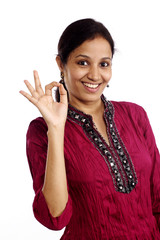 Young beautiful indian woman making OK sign