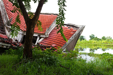 Ruins of the thai house has red roof broken down.