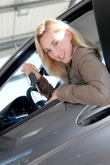 Smiling woman holding brand new car key