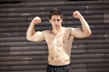 Athlete showing his muscles
