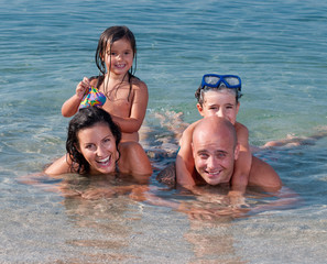 Happy family having fun in the sea