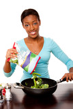 Health conscious woman preparing vegetables poster