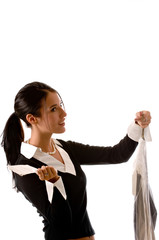 Young woman picking up her dry cleaning.