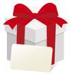 赤いリボンのギフトボックスとメッセージカード