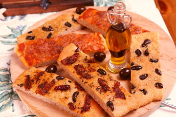 Tasty focaccia breads on italian board