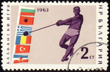 Athlete with hammer on post stamp