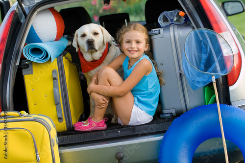 Girl with dog ready for travel for summer vacation