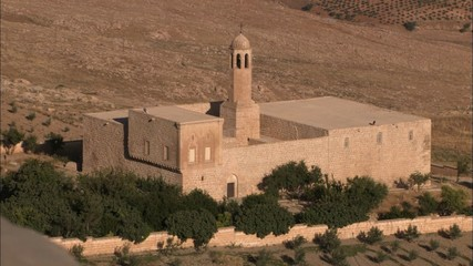 WS of arabic christian fortress in desert.