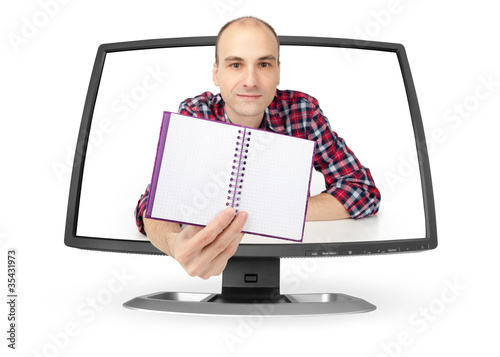 man showing notepad through the monitor
