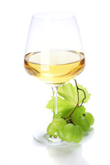 wineglass with white wine and grape