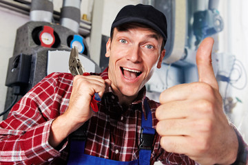 plumber with multigrip pliers and thumb up