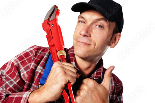 plumber with casing tongs and thumb up