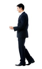 Full body of walking businessman, on white