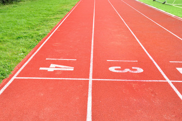 a part of an outdoor stadium - running tracks