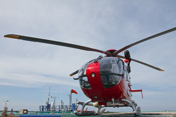 Helicopter standing on offshore platform