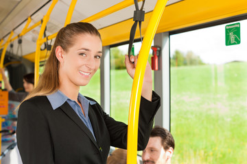 Female passenger in a bus