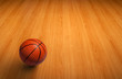 A basketball on wooden floor