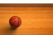 A basketball on wooden floor as background
