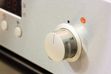 controls from a modern stainless steel oven