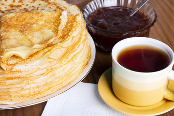 Pancakes with jam and tea