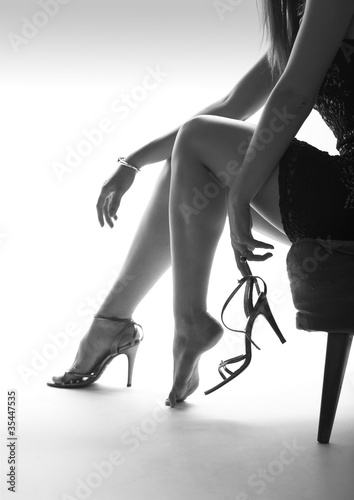 Sexy woman legs and high heels, white background