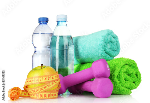 towel, dumbbells, apples and water bottle isolated on white