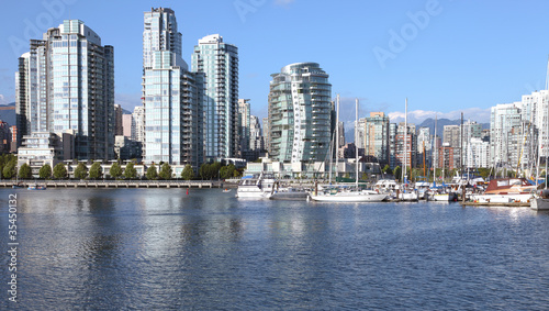 Vancouver BC south waterfront skyline & sailboats.