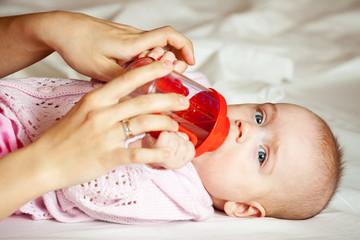Feeding procedure of little baby