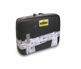 Koffer mit TSA-Klebeband und Hawaii-Aufkleber