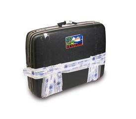 Koffer mit TSA-Klebeband