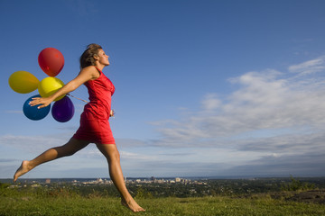 Woman in Red with Balloons Jumps