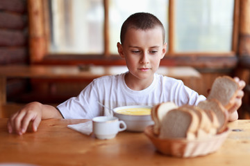 Child eating soup in a restaurant