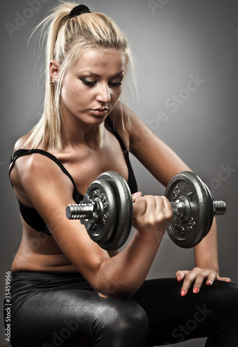 Young athletic woman doing workout