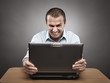 Angry businessman at laptop