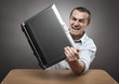Angry businessman smashing his laptop