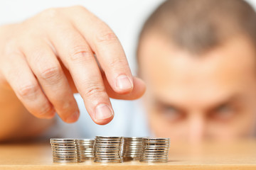 Businessman hand reaching for pennies