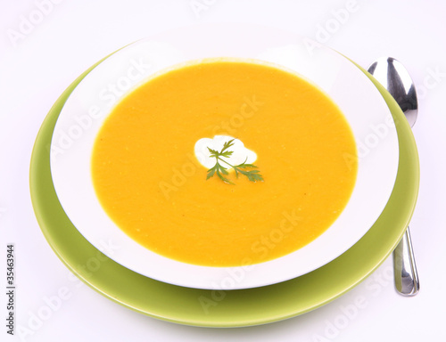 Pumpkin Soup decorated with cream and parsley