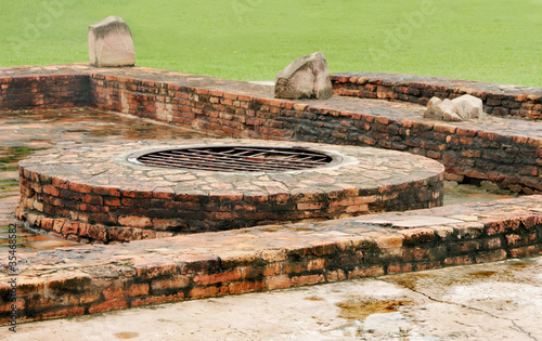 Ancient well at monastery ruins site Sarnath