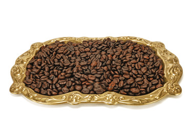 grains of roasted coffee on a tray