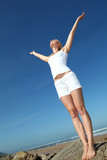 Woman stretching arms up from freedom - Fine Art prints