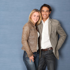 Couple standing on grey background