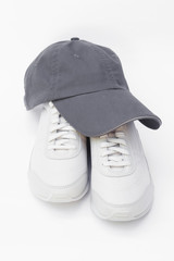 Running shoes and baseball cap